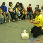 Luis teaching culturally competent first aid.