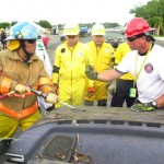 Jeff teaching a Bombero on how to use a AJAX air chisel.
